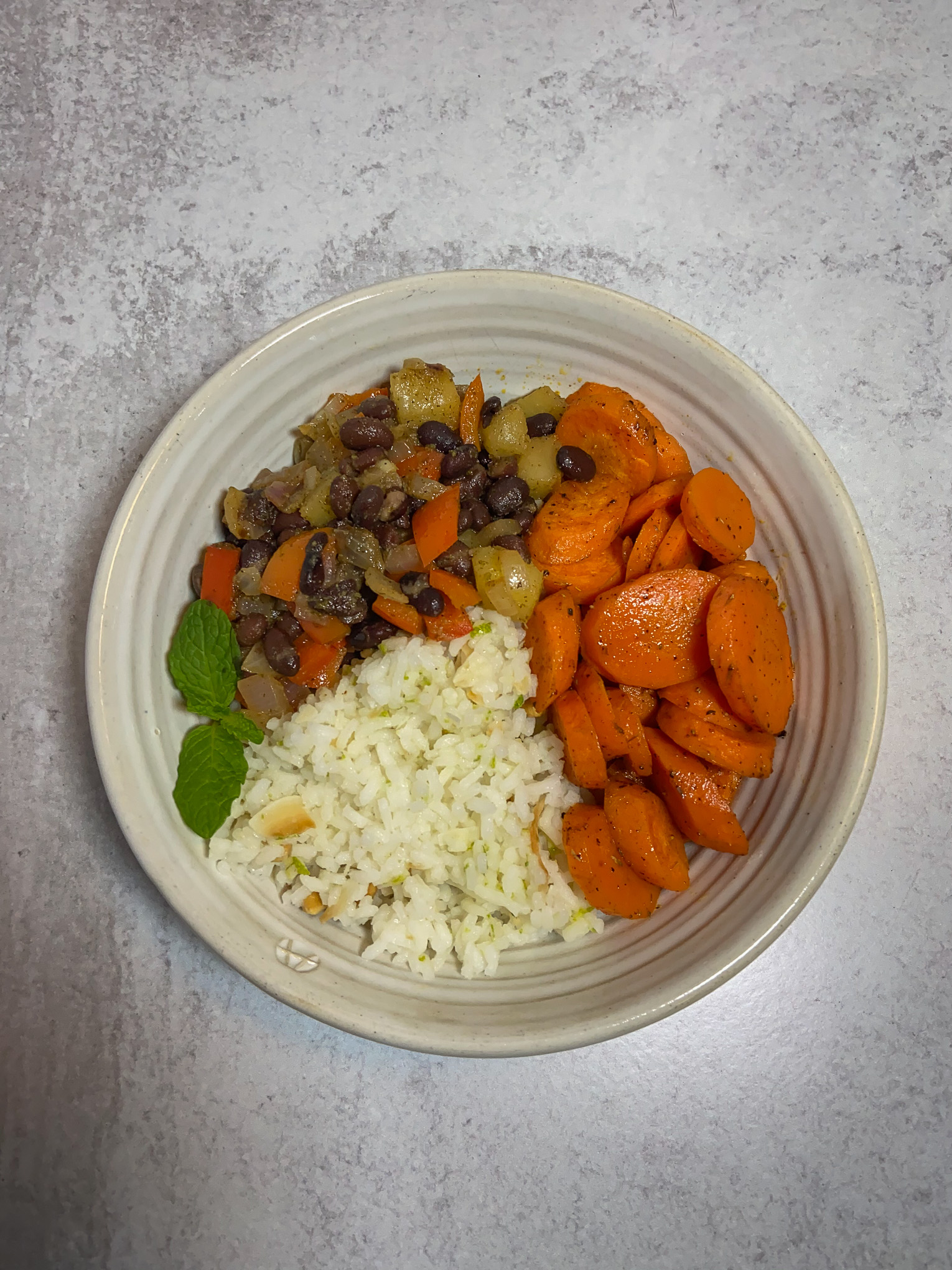 Bowl of rice, beans and carrots