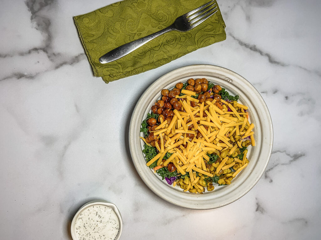 Top down bowl of beans, greens and cheese