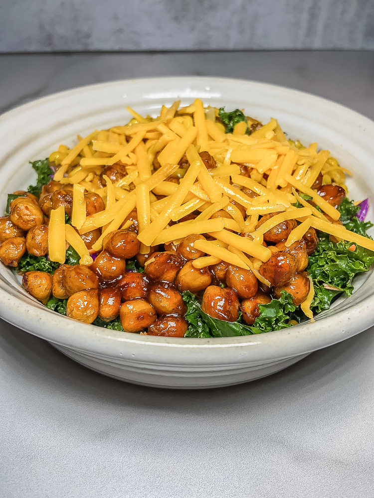 Bowl of chickpeas, greens and cheese