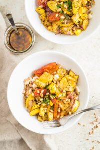 Two bowls of roasted veggies
