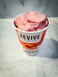 Pink smoothie in a paper cup