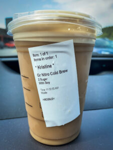 Starbucks iced coffee drink in a cup on a dashboard
