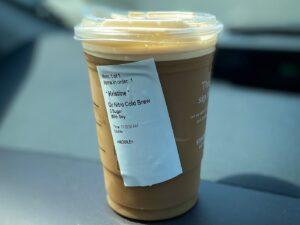 Starbucks nitro coldbrew in a to go cup on car dashboard