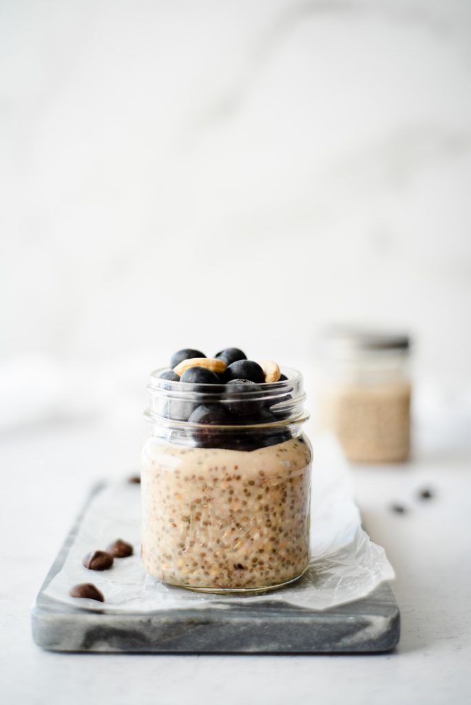 Small jar of chia pudding topped with blueberries