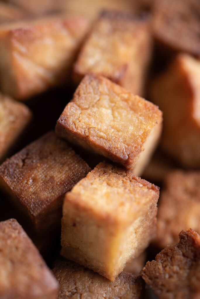 Close up of baked cubes of tofu