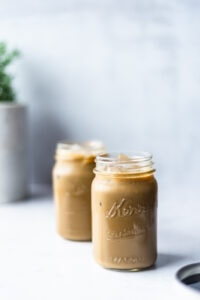 Two mason jars filled with molasses flavored milk