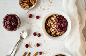 Top down view of bowls of hot cereal with cranberries