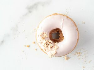 Close up view of the top of a pink donut