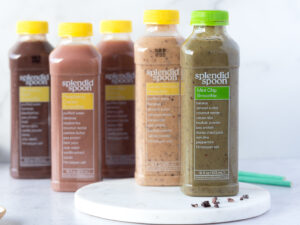 Several bottles of brightly colored smoothies