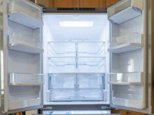 Empty French door refrigerator with doors open