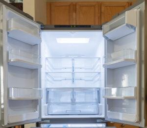 Empty refrigerator with doors open