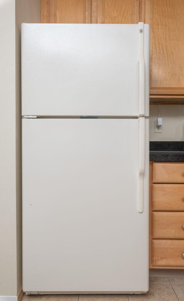 beige freezer on top refrigerator