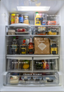 LG refrigerator full of food with some sections labeled