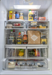 Refrigerator full of food several shelves