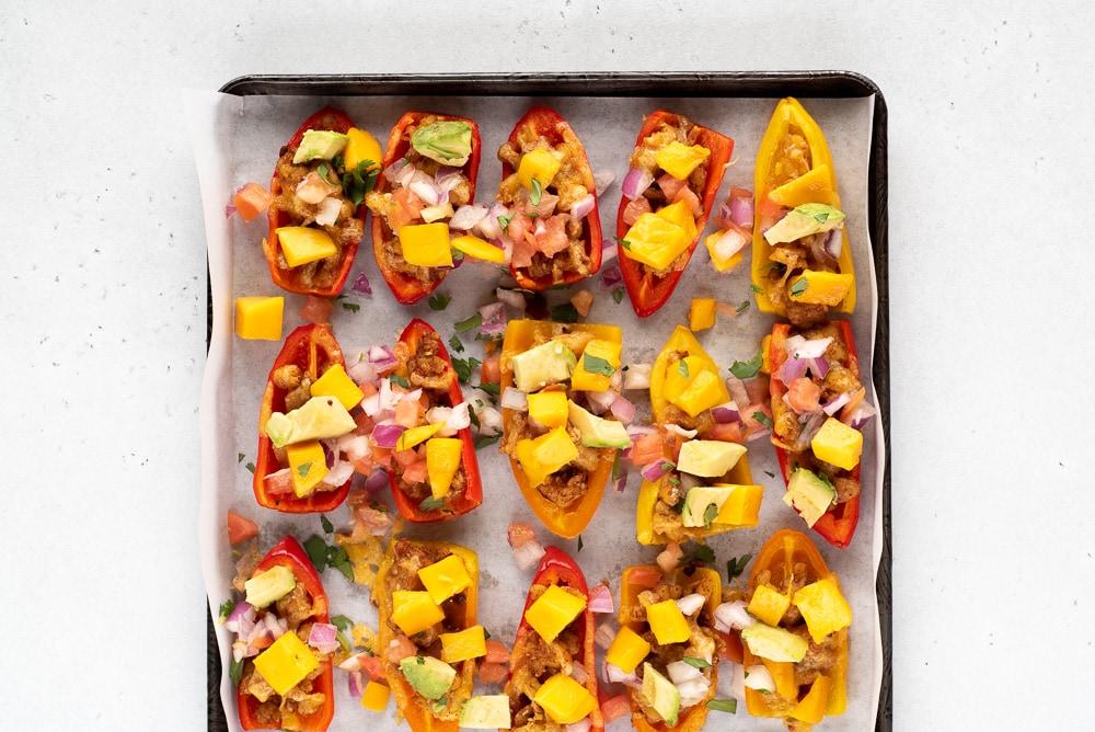 Cookie sheet full of mini pepper nachos