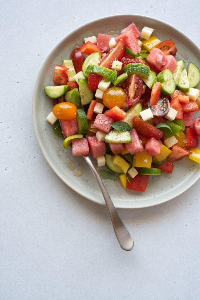 Top down view of single plate full of veggies