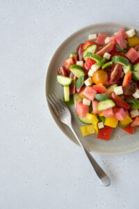Top down of a plate full of colorful fruit and veggies