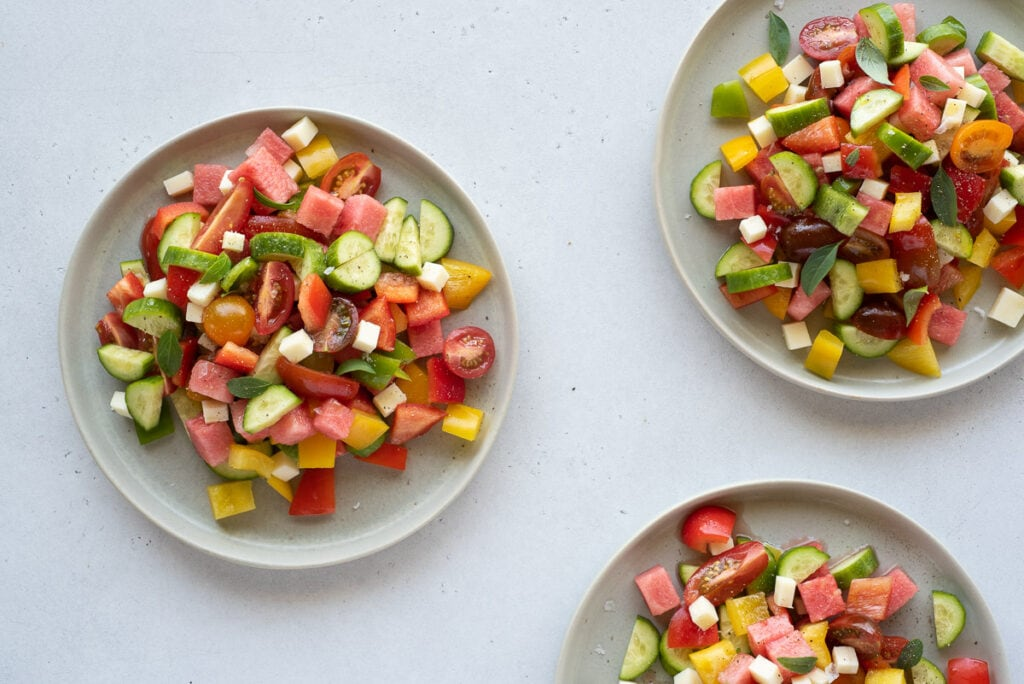 Top down of 3 plates filled with colorful vegetable salad