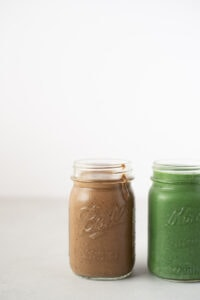 Two mason jars filled with smoothie