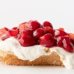 Meringue dessert topped with cherries