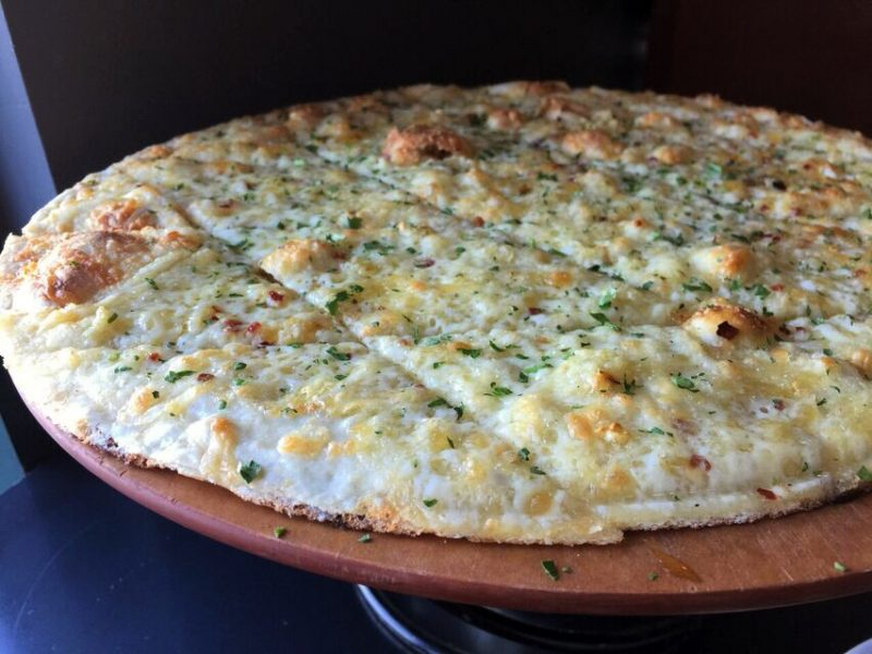 Cheese bread that is round like pizza