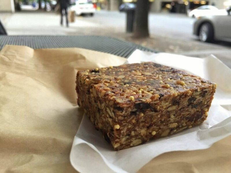 Extra thick granola bar on a piece of waxed paper