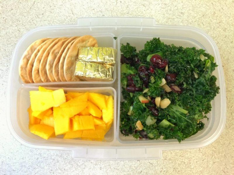 Kale salad, mango, cheese, crackers bento lunch