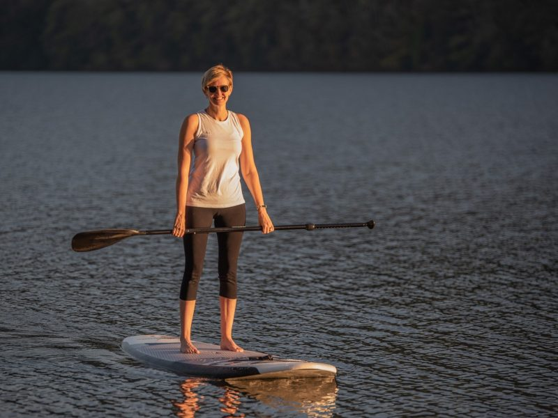 Woman on a paddle board in a lake
