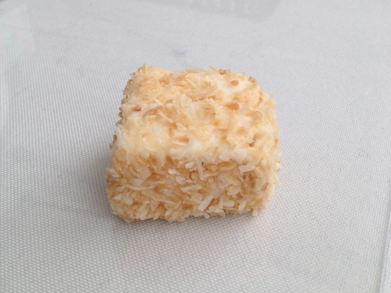 Square marshmallow covered in coconut