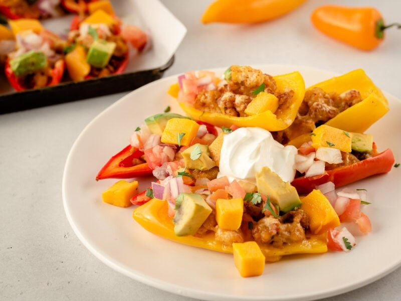 Plate with mini pepper nachos and sour cream