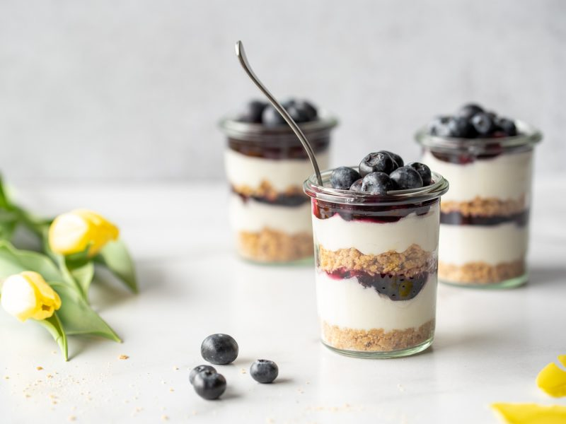 Three jars of blueberry cheesecake and some tulips