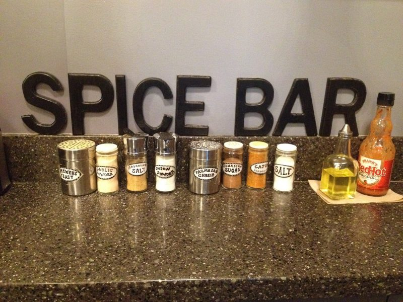 Counter at a movie theater with a selection of popcorn seasonings