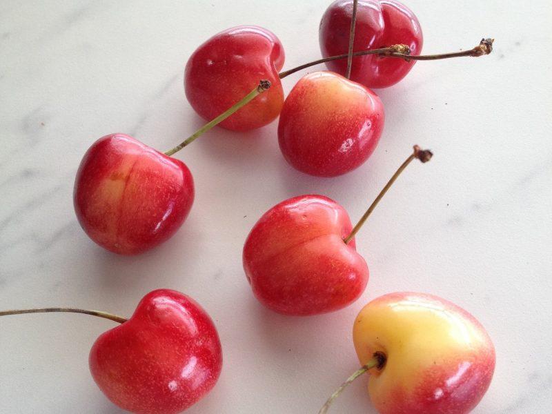 Rainier cherries scattered on counter