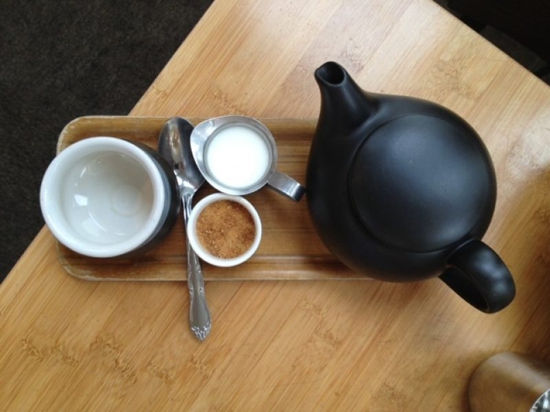 Top down view of a teapot and tea cup in a tea house